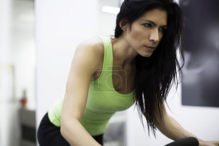 Woman exercising in  cycling class