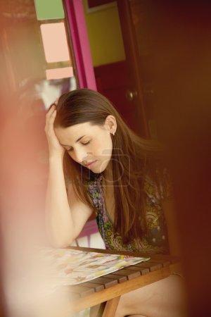 Sad young woman sitting