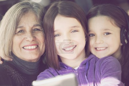 little girls with grandmother taking a selfie