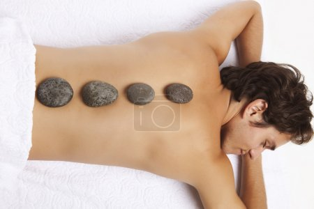 man getting stones treatment