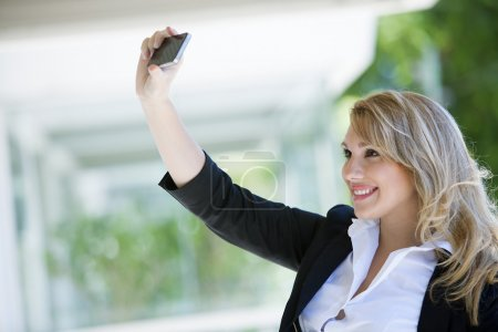Beautiful woman making selfie