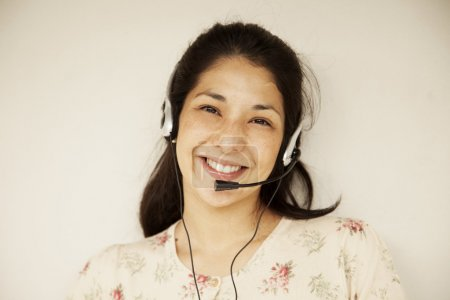 Woman in headset smiling