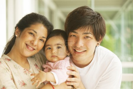 Asian family smiling