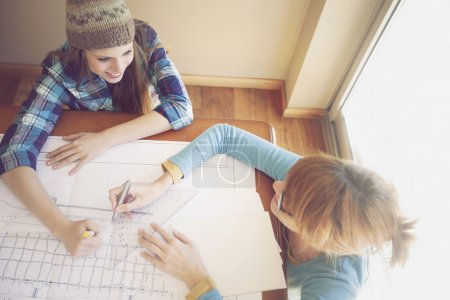 Women working with blueprints
