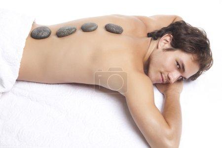 Man getting stones treatment