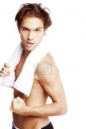 Young man with towel posing