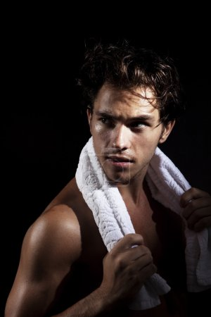 Man with towel posing