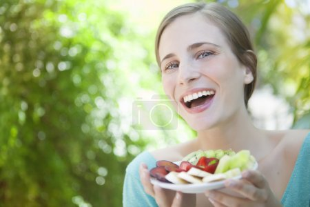 Woman hoding fruit salad