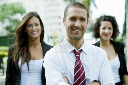 Businesspeople smiling outdoors