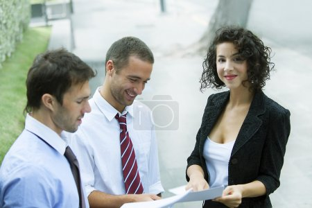 Businesspeople discussing something