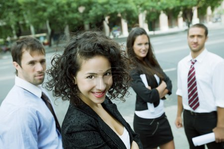 Businesspeople posing outdoors