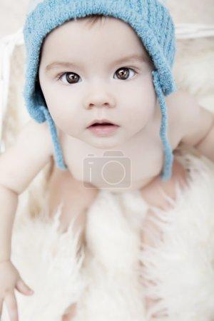 baby in hat posing