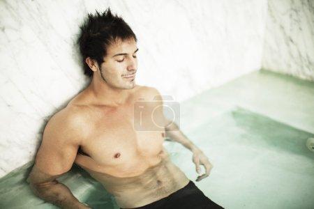 Man relaxing in pool
