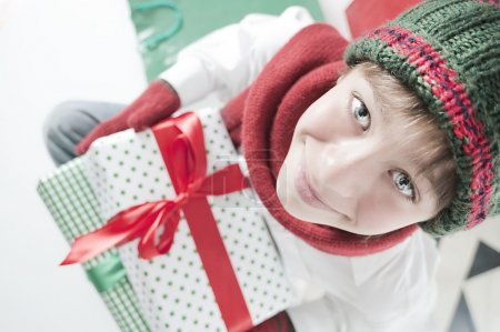 teen Boy holding Christmas Gift
