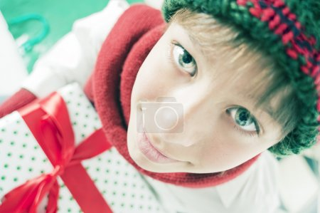teen Boy holding Christmas Gift