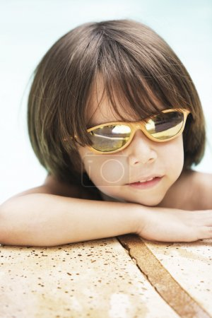 boy in glasses posing