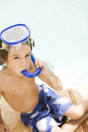 boy posing in pool