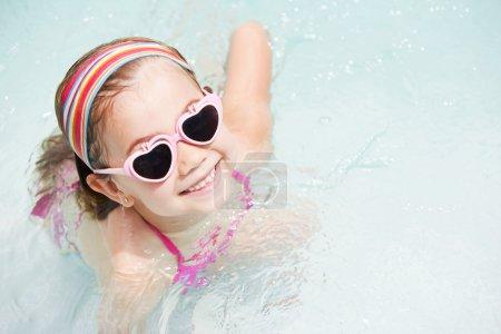 girl having fun in pool