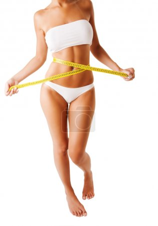 Photo for Young woman measuring waist - Royalty Free Image