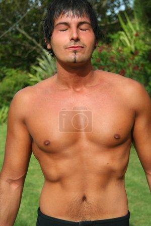 Shirtless young man posing