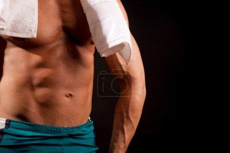 fit man posing in gym