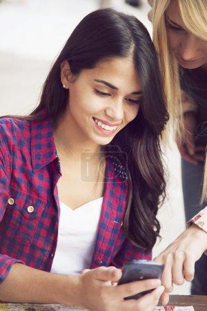 Young women using phone