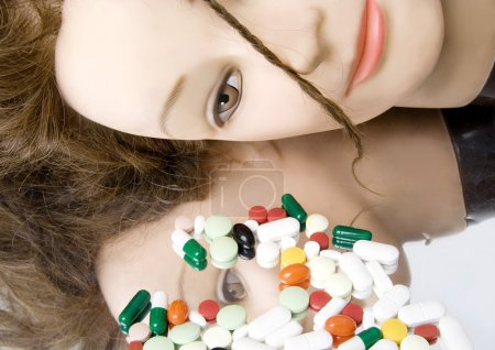 mannequin and colorful pills
