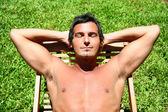 man with closed eyes sunbathing