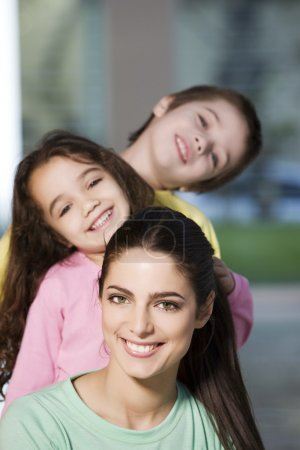 happy mother with children  posing
