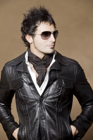 man in leather jacket posing