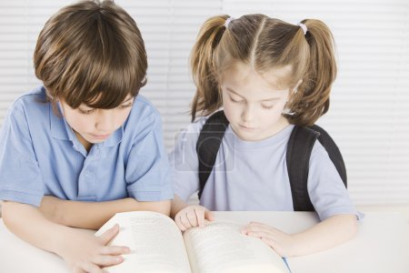 cute boy and girl reading