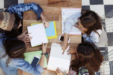 Girls studying sitting at desk