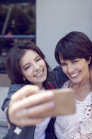 mother and girl taking self picture