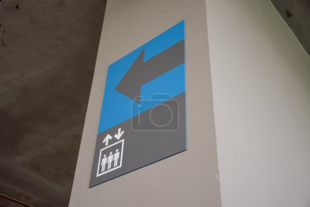 Blue and gray elevator sign in the car park floor 5.