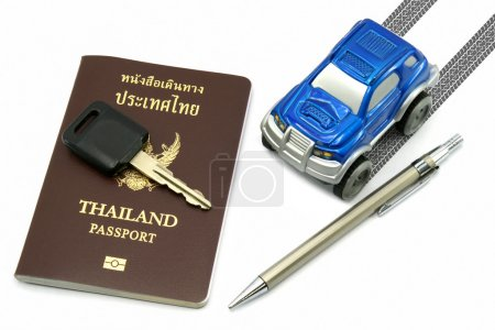Thailand passport, key, pen and blue 4wd car for travel concept