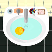 Top view on a sink in a bathroom with the yellow rubber duck