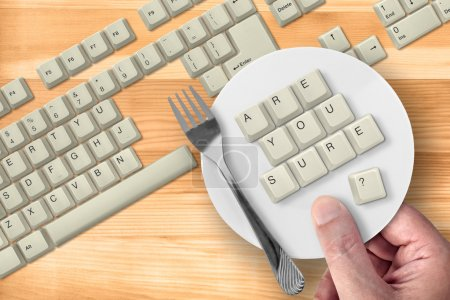 """Photo pour Keys, from old computer keyboard, spelling """"Are You Sure?"""". Don't make a mistake! It's no cake, even if you have saucer and fork. - image libre de droit"""