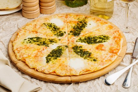 Photo of crunchy pizza on wooden plate