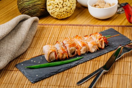 Grill meat on a wooden skewer with green onions