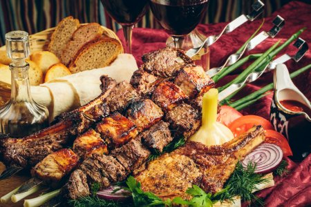 Photo for Fried grilled meat with vegetables, sauce and wine in glass glasses - Royalty Free Image