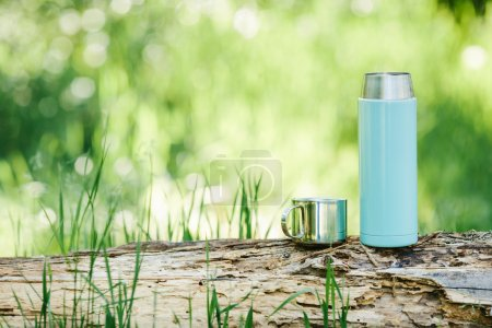 Photo for Water bottle on wood  with summer scene background - Royalty Free Image