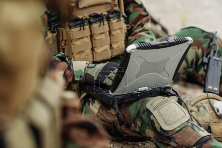 ranger using laptop outdoors