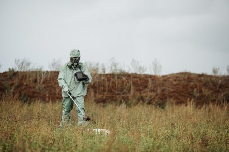 Scientist (radiation supervisor) in protective clothing and gas