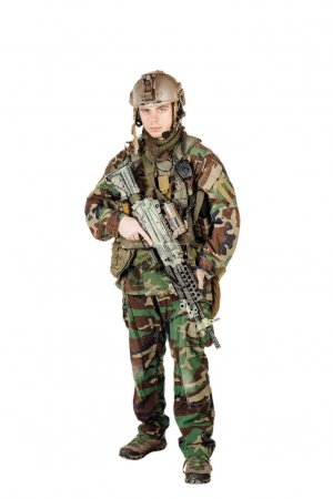young ranger standing with a machine gun at white background