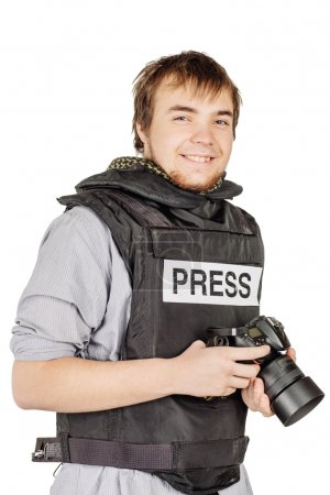 press photographer wears a protective vest and takes photos with