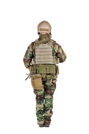 Ranger standing in woodland camouflage and modern machine gun. I