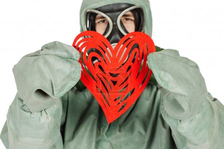 Man with protective mask and protective clothes with red heart