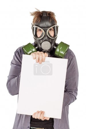 Man with protective gas holding a blank sheet of paper. portrait