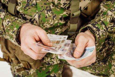 serviceman with russian ruble money his hand.
