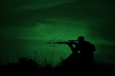Silhouette of military sniper with weapons at nigh...